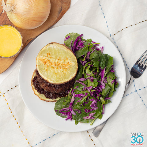 100% grass-fed beef burger on sweet potato bun with onion jam + side salad with citrus vinaigrette