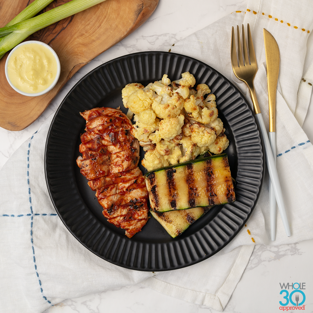 "pasture-raised bbq chicken + cauliflower ""mac and cheese"" and grilled  zucchini"