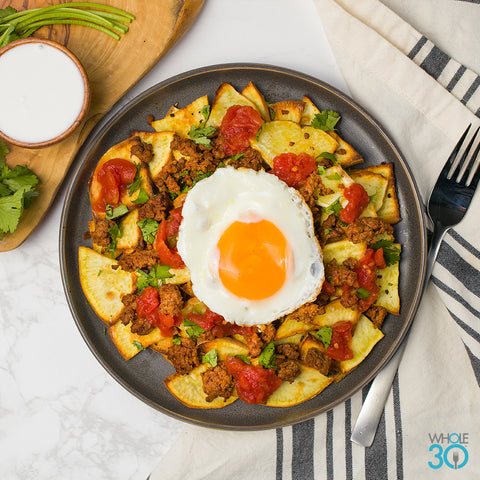 sweet potato chorizo chilaquiles with sour cream