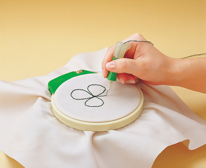 clover embroidery stitching tool in use