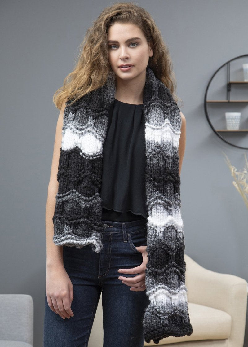 girl wearing scarf made with Premier Couture HOME yarn