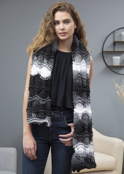 young woman wearing scarf knitted with Premier Couture Home yarn