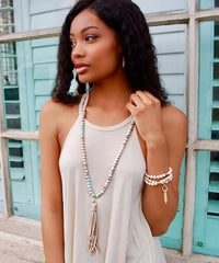 Cream Fossil & Carolina Blue Gemstone & 10K Gold Metal Tipped Suede Tassel Necklace