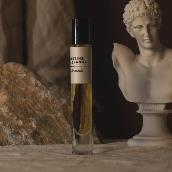 Chypre perfume oil bottle on standing by ancient Greek sculpture