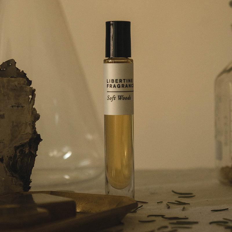 fir perfume oil surrounded by glassware