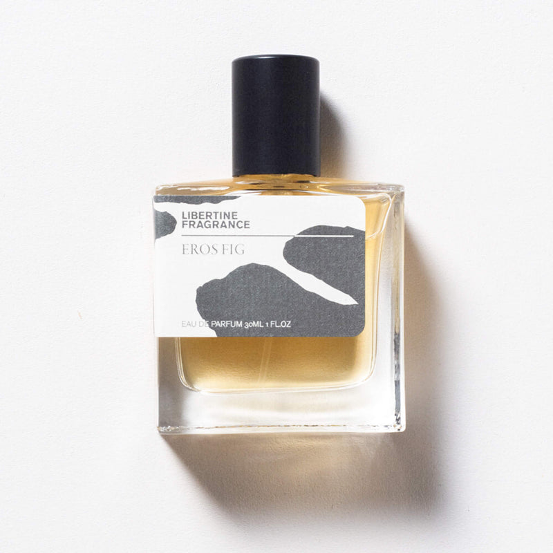 fig perfume on white background