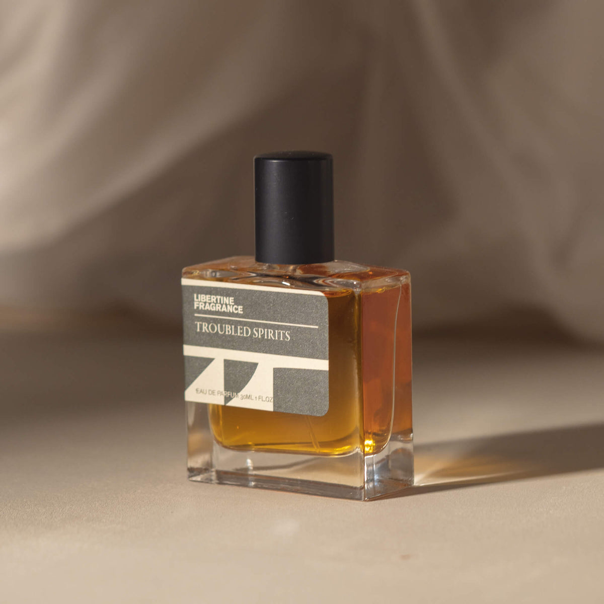 Warm perfume in square bottle standing by minimal packaging