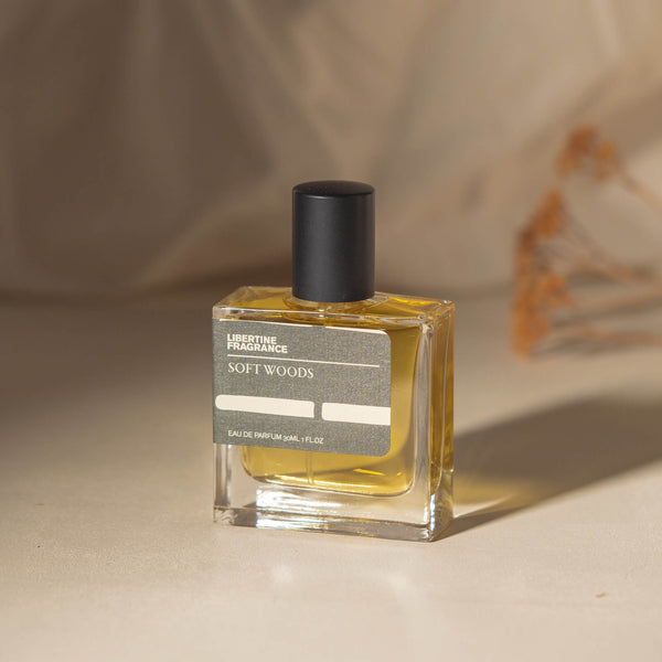 minimal perfume laying in pine needles