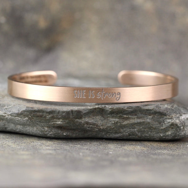 SHE IS STRONG inspirational message Cuff Bracelet - Stainless Steel in your choice of rose, yellow, steel or black - Engraved Bracelet