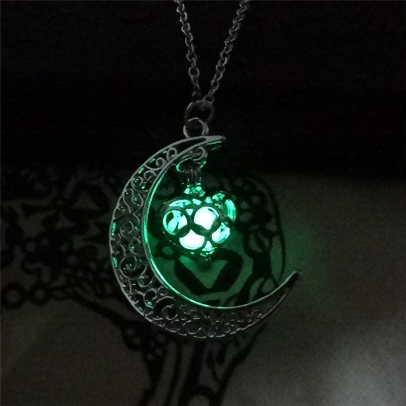 green crescent glow in the dark necklace