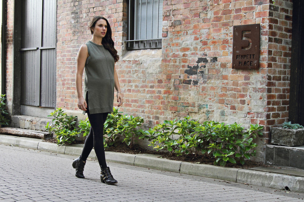 pregnant lady in stylish black sustainable leggings