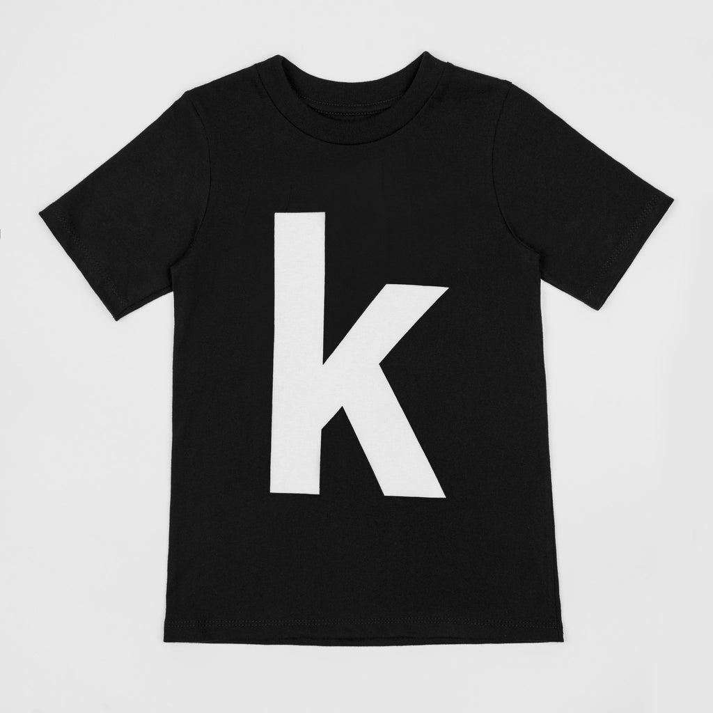 Letter K printed white on black t-shirt