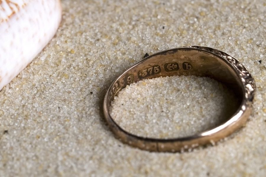 9 ct gold ring on the sand