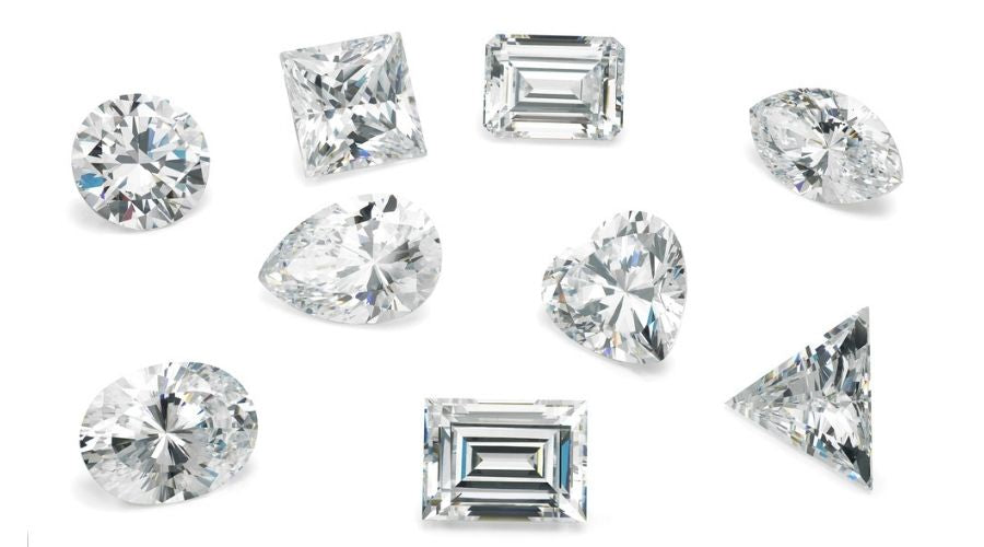 Different diamond cuts and styles on white background