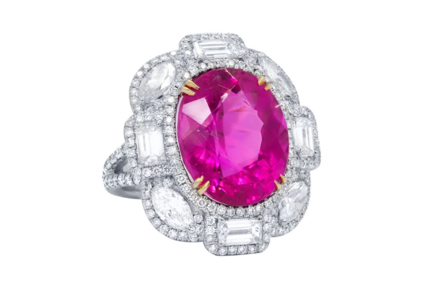 Close up of a pink sapphire and diamond ring.