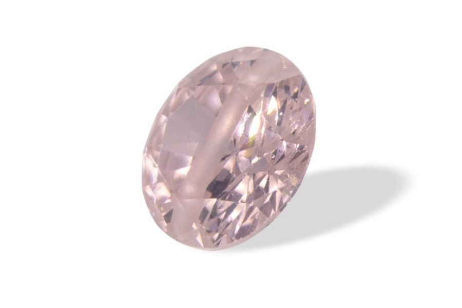 Faceted pink zircon on a white background.