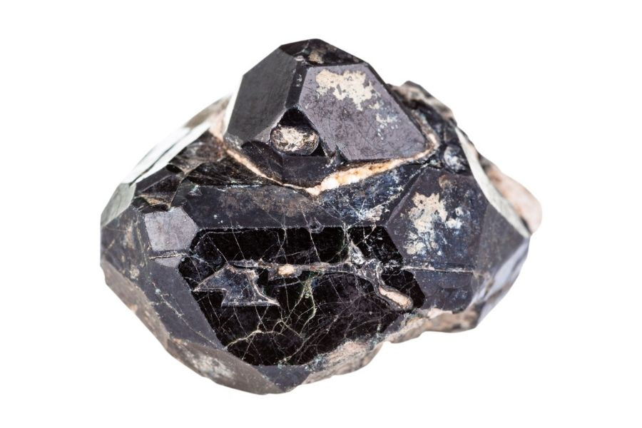 Close up of black spinel on a white background