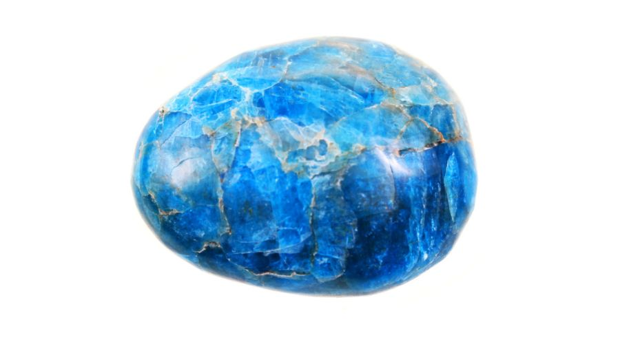 Blue apatite stone isolated on a white background