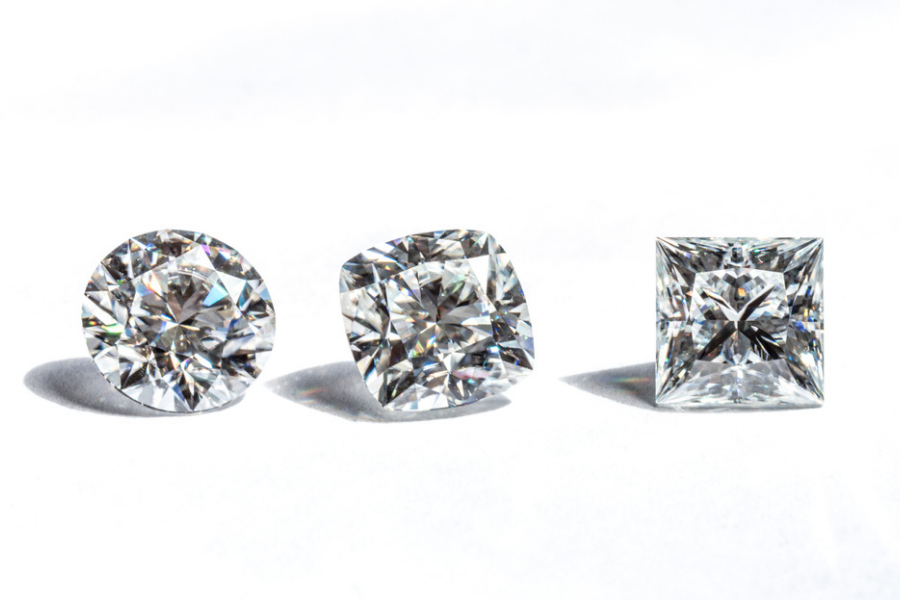 cushion cut and round cut diamonds side by side