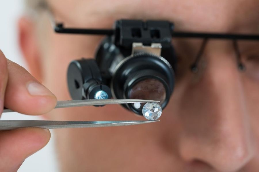 a man checking diamond quality