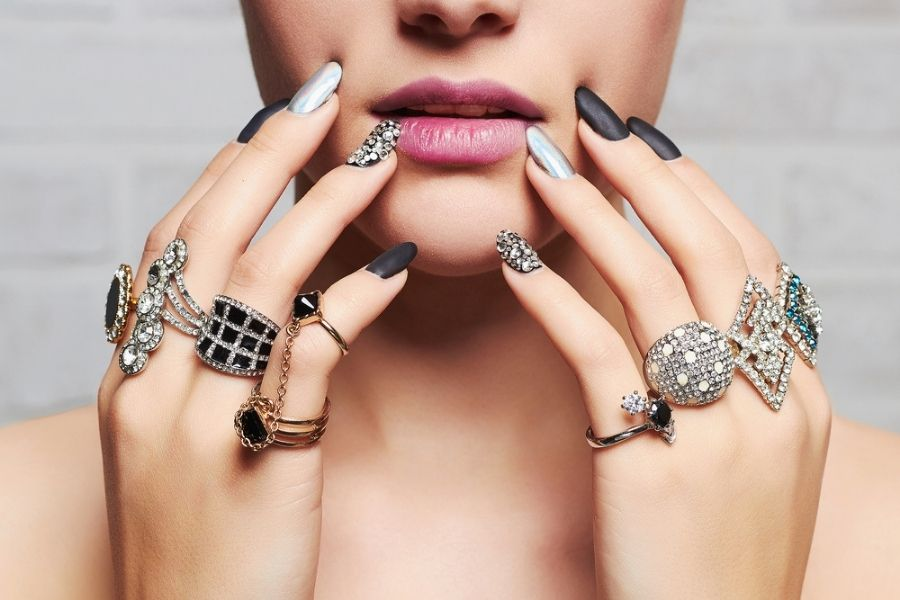 fashionable woman with rings on all fingers