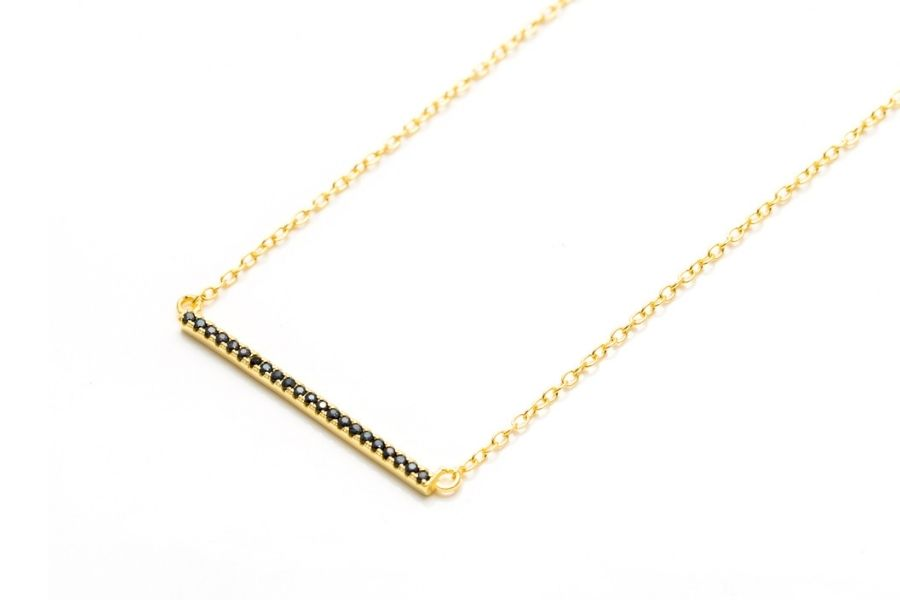 gold bar necklace with black diamonds