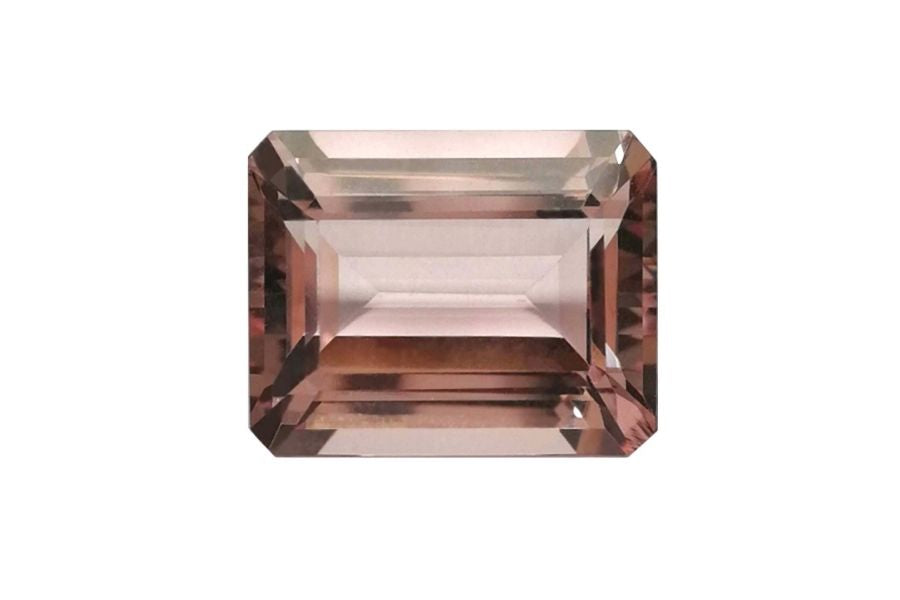 Faceted morganite on a white background.