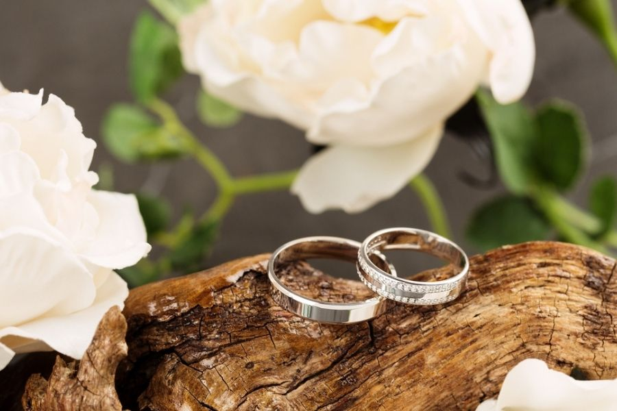 palladium and platinum rings with flowers in background