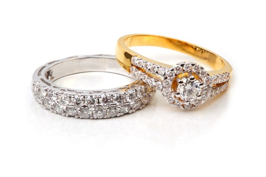 platinum and gold diamond rings side by side