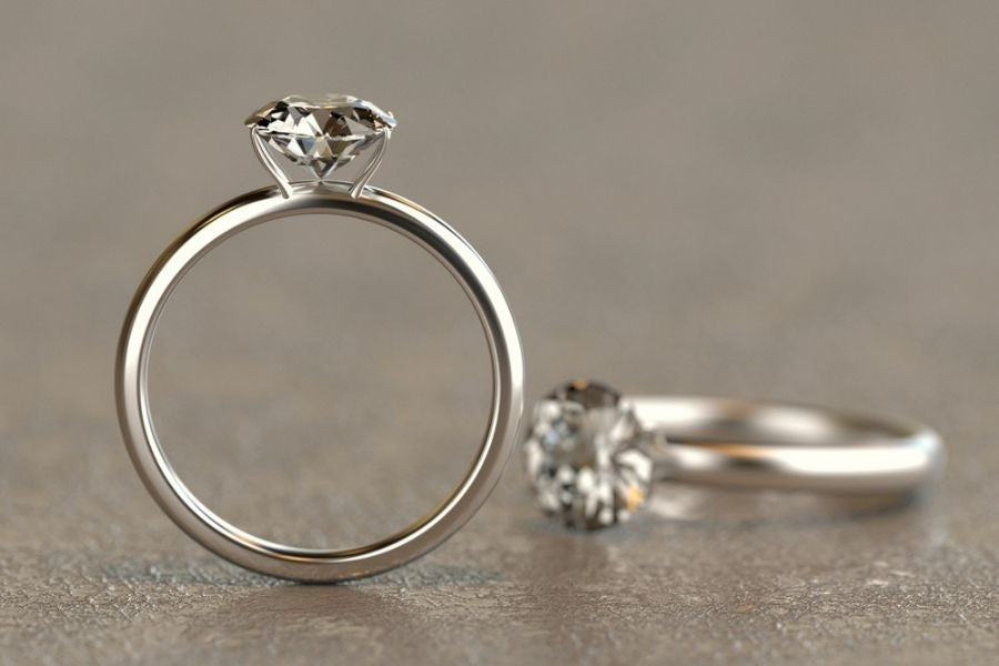 platinum vs silver - two engagement rings on a table