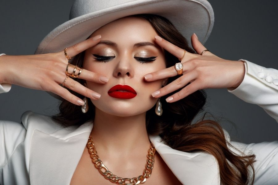 pretty woman with red lipstick showing off multiple rings