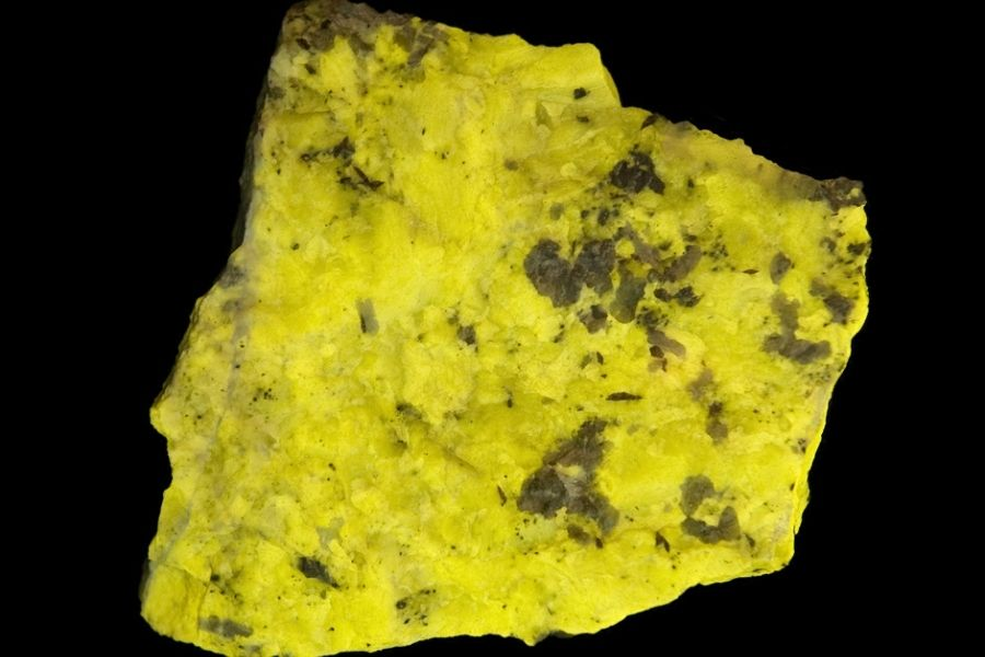 Close up of scapolite on a black background.