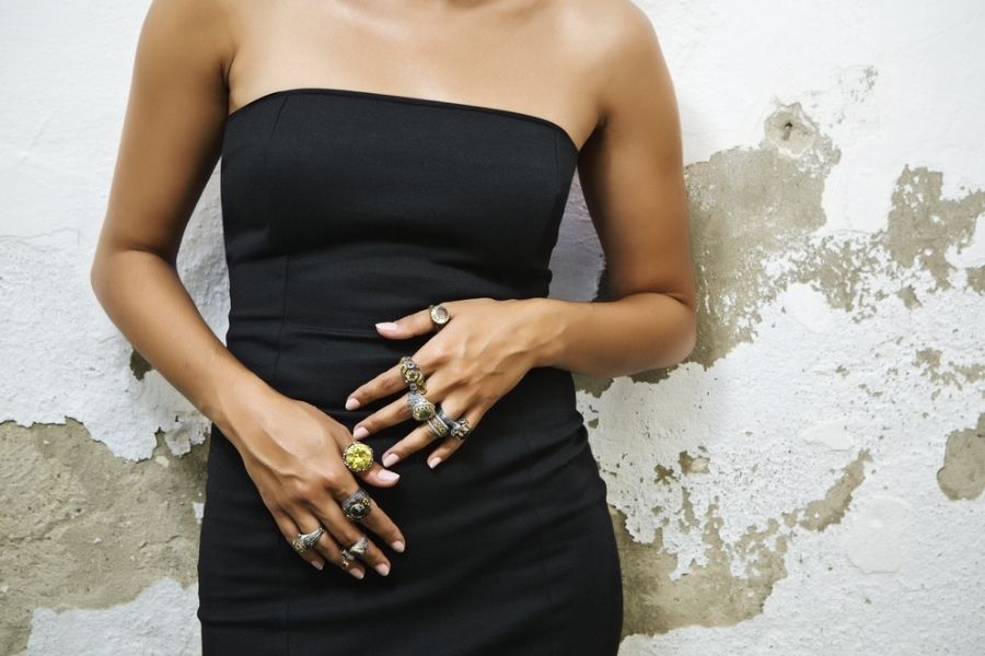 woman with a lot of unique rings on both hands showing off her personal style