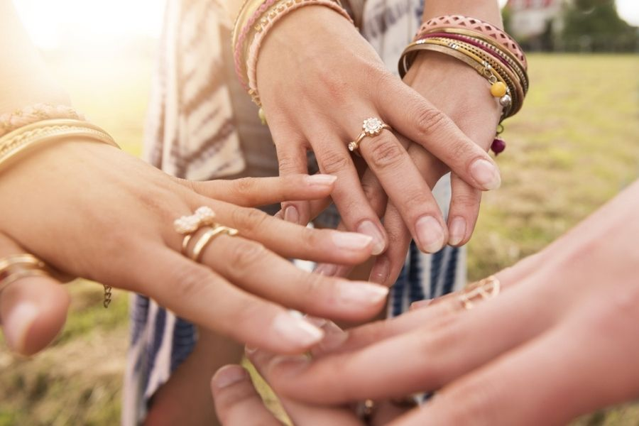 women with rings on different fingers showing what their rings mean
