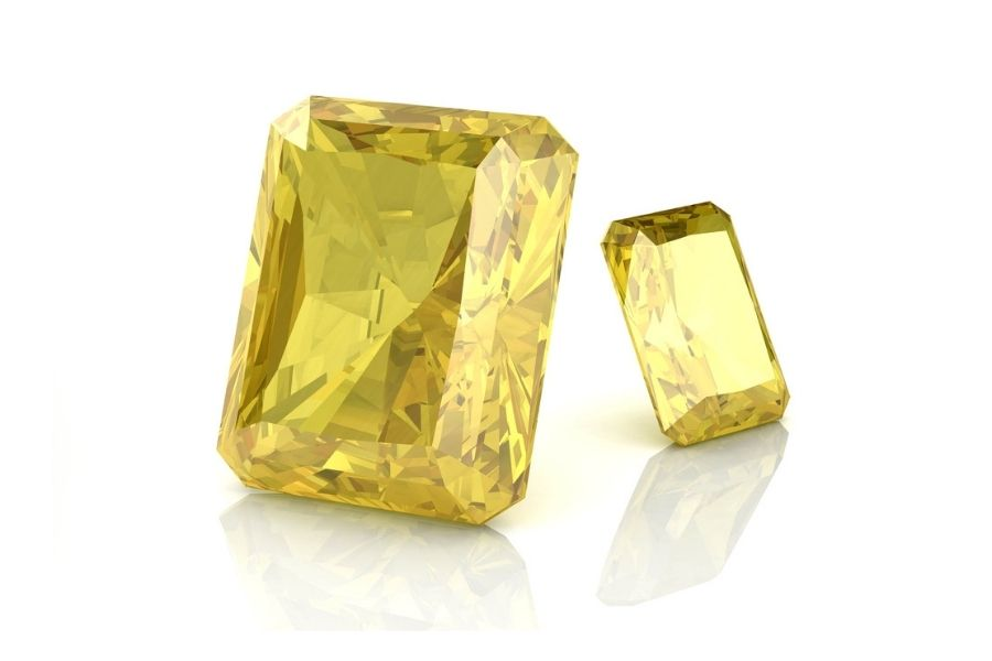 Yellow sapphire stones on a white background.