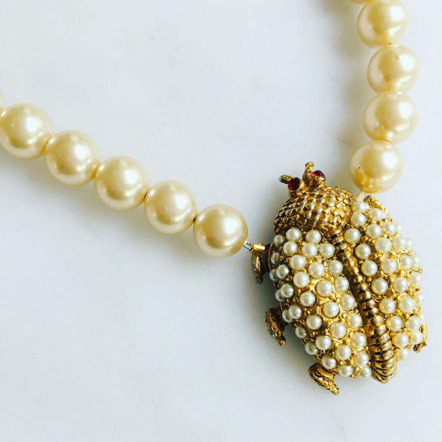 Beautiful pearl and gold ladybug, set by hand