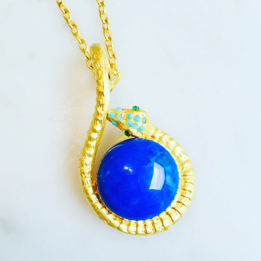 Stunning 20mm lapis snake, in 22ct gold over silver wit turquoise