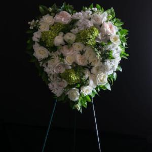 Filled heart spray sympathy flowers with with white flowers