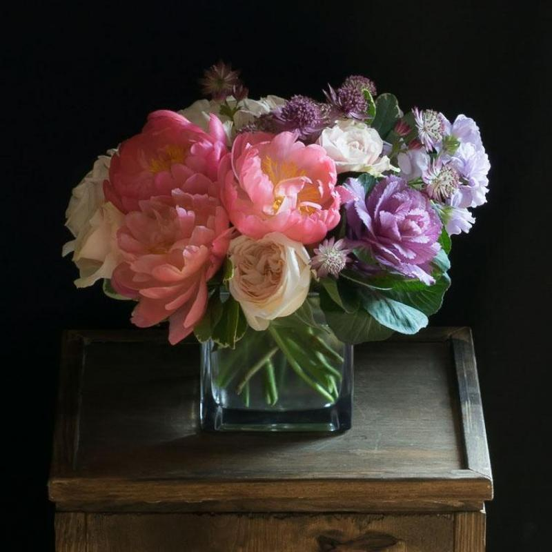 Flower arrangement with pink peonies and pink garden roses.