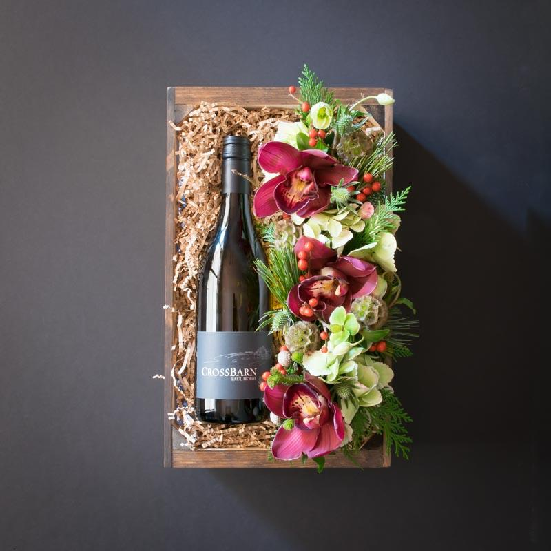 Box with wine and flowers, burgundy orchids.