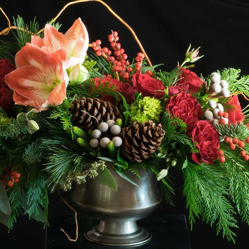 Christmas Holiday Flowers - flower arrangement with red roses, cones, and red amarylis.