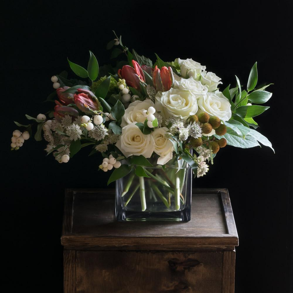 Boutique flower arrangement using the best premium flowers with white roses and red tulips.