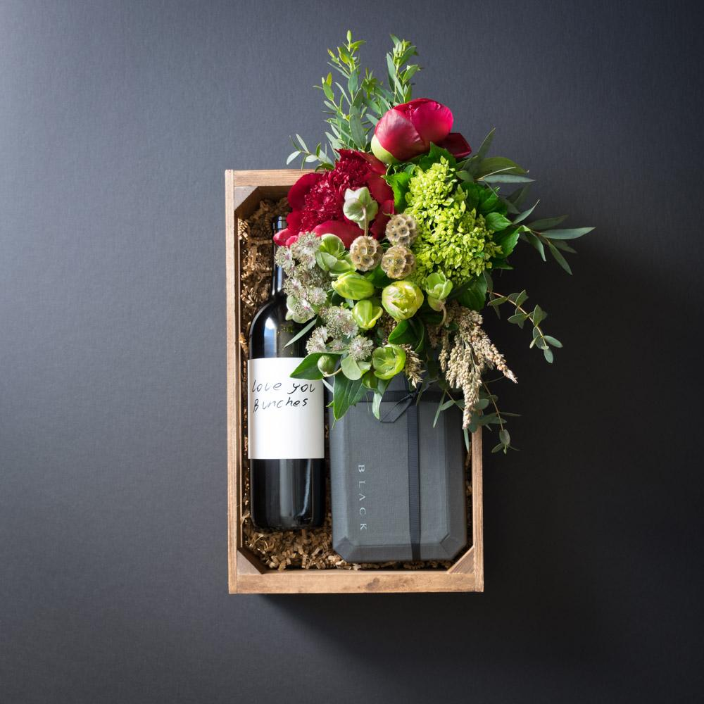 Luxury boutique gift box with flowers, peonies, 15 pc Black Box  Norman Love ultra-premium chocolate and organic red wine.