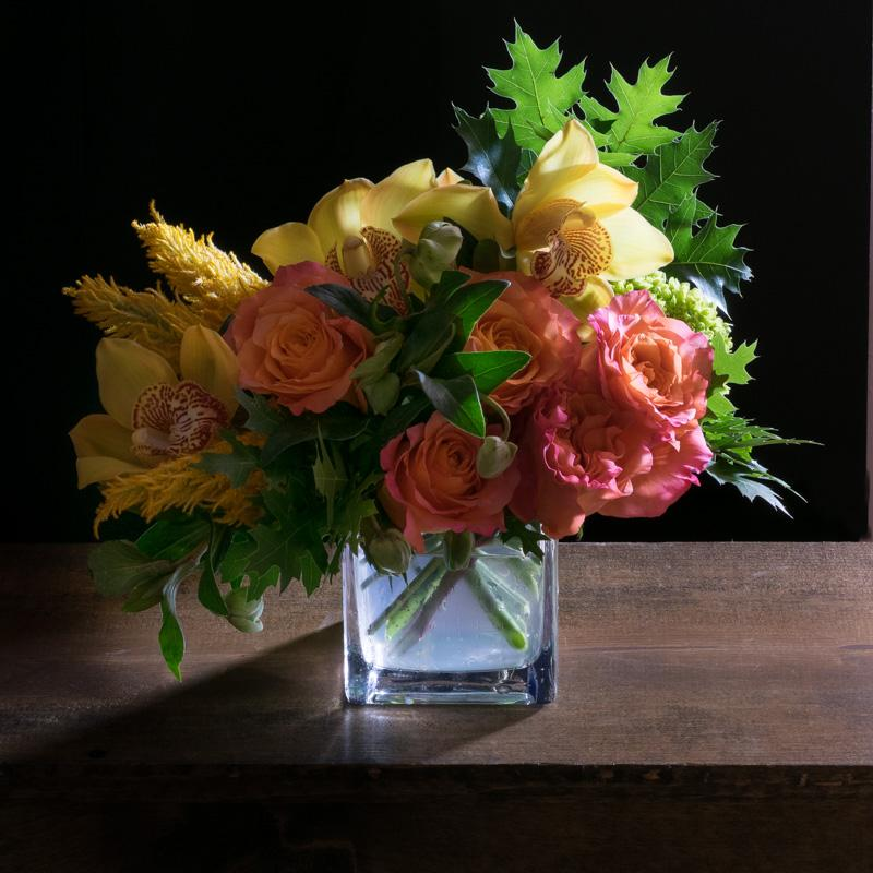 Fall flowers arrangement with orange roses and yellow orchids