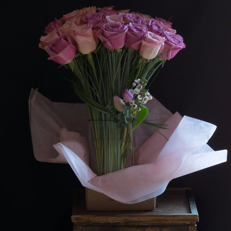 Pink roses flower arrangement of 2 dozen long stem roses.