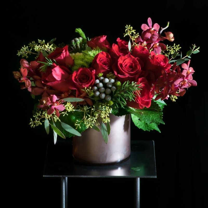 Unique beautiful holiday, Christmas floral arrangement with red roses