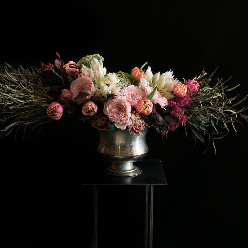Luxe floral design with pink, burgundy, and white flowers.
