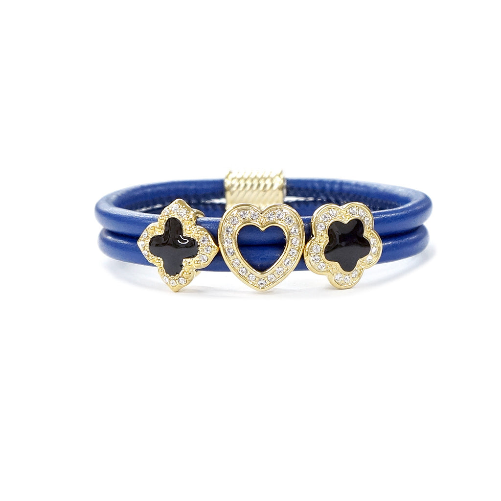 Clover, heart, flower charms on blue leather bracelet
