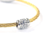 silver tone rhinestone charm on gold tone wire cable bangle