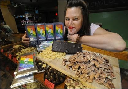 Stefan Hard / Staff Photo Stefan Hard / Staff Photo Nutty Steph's activist owner Jaquelyn Rieke poses Tuesday with Pride Bars and some of the ingredients that go into the bars created by the Middlesex chocolatier to help raise funds the LGBT community thr